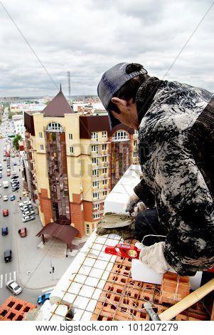 Bricklayer behind work