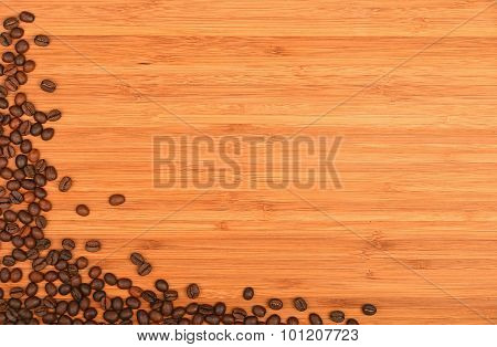 Coffee Beans Corner Over Bamboo Wood Background