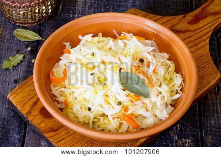 Sauerkraut In A Bowl On A Wooden Table