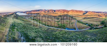 aerial panorama of foothills near Fort Collins, Colorado with Horsetooth Reservoir, Lory State Park, Charles Hansen Canal and Centennial Road, sunrise at late summer