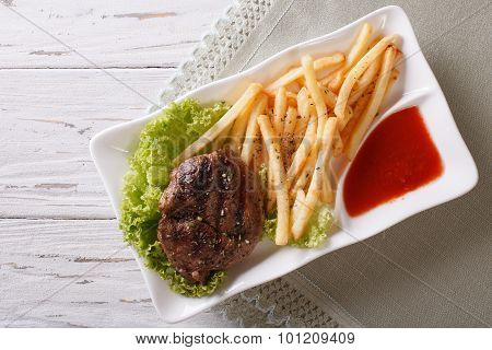 Serving Grilled Beefsteak With French Fries And Sauce. Horizontal Top View