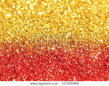 Blurry background of golden and red glitter sparkle