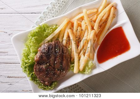 Grilled Beefsteak With French Fries And Sauce Closeup. Horizontal Top View