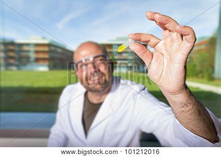 Chemist With Yellow Liquid