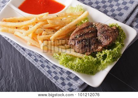 Grilled Beefsteak With French Fries And Lettuce On The Plate. Horizontal