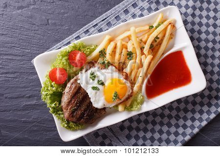Grilled Beefsteak, Fried Egg And French Fries. Horizontal Top View