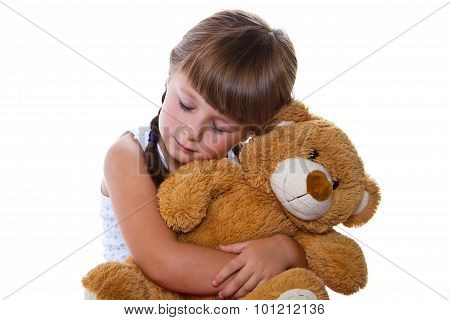 Adorable Toddler Girl Hugging A Teddy Bear