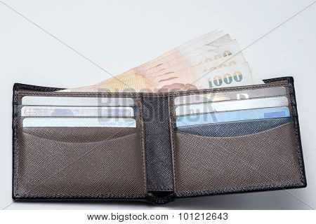 Thai Money And Credit Card In Lather Wallet .