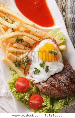 Fried Potatoes, Egg, Grilled Beefsteak With Ketchup Macro. Vertical