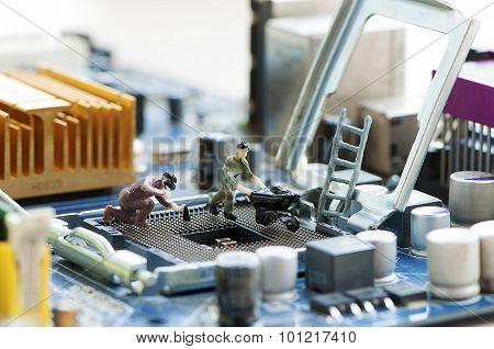 Miniature Workers Repairing A Processor