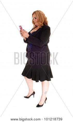 Businesswoman Texting On Her Cellphone.