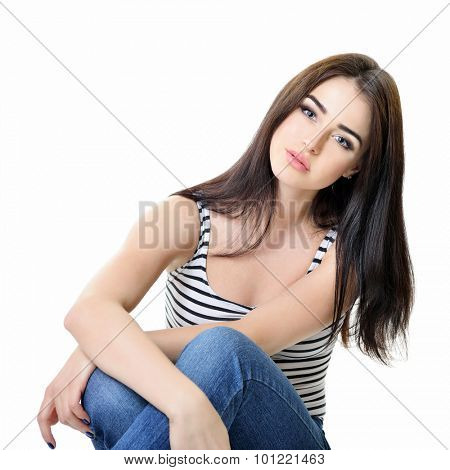 Beautiful woman staring straight at camera, over white background