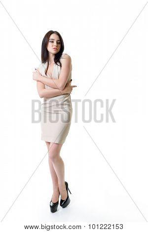Beautiful woman in beige dress close up. Full length portrait.