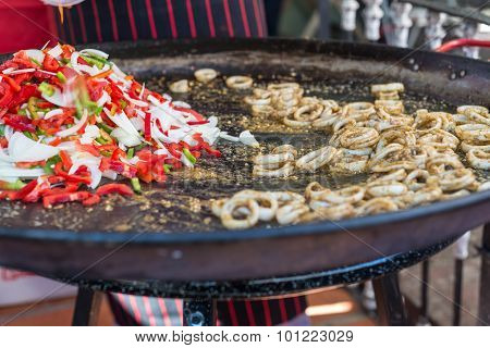 Traiditional Cuisine Traveling Uruguay, Local Paella, Squid With Onion And Pepper. South America.