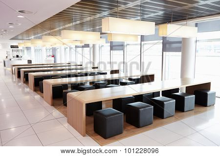 Seating in the empty cafeteria of a large business