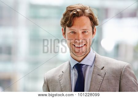 Corporate businessman in modern interior, head and shoulders