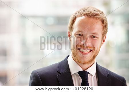 Head and shoulders portrait of a young businessman smiling