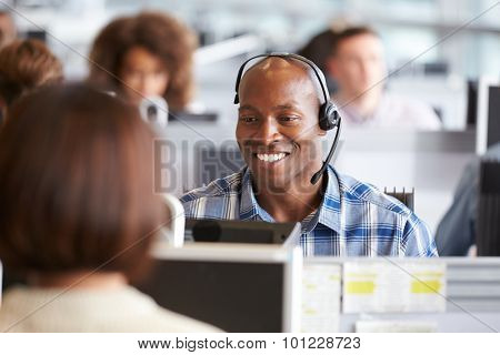 African American man working at a computer in a call centre