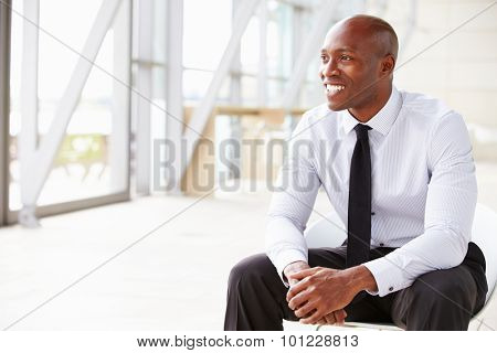 African American businessman looking away, horizontal
