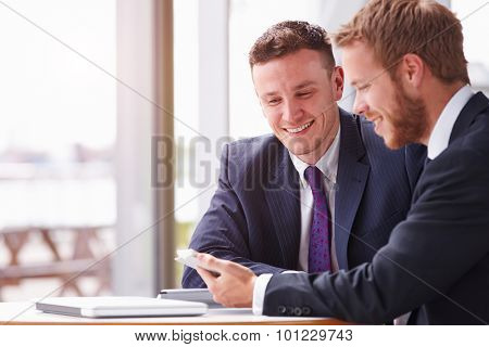 Two business colleagues in a meeting, close up