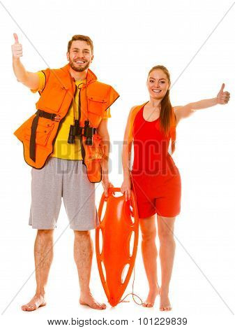 Lifeguards In Life Vest With Rescue Buoy. Success.