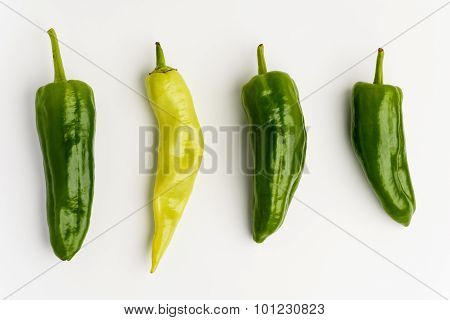 Green And Yellow Peppers On White Background