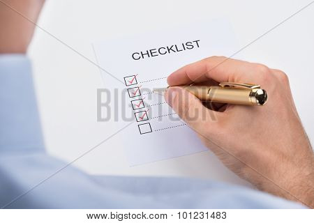Person Filling Checklist Form