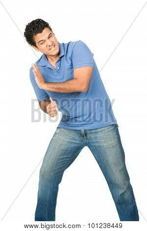 Man Leaning Body Weight Against Side Object