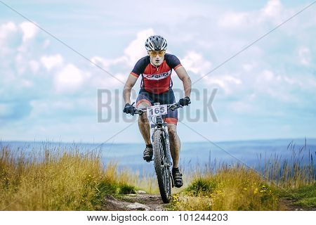biker on mountain top