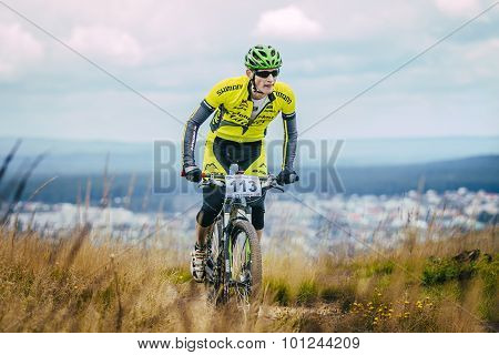 mountain biker climbed top of the mountain