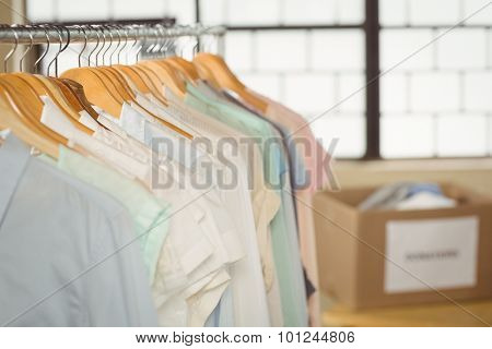 Clothes hanging on rack in office