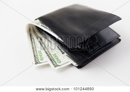 finance, investment, saving and cash concept - close up of dollar money in wallet