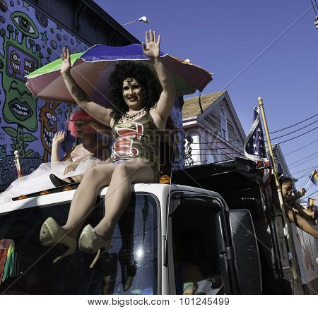 People riding in the 37th Annual Provincetown Carnival Parade in Provincetown, Massachusetts.