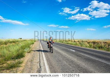 The Bicycle Rider On The Road.