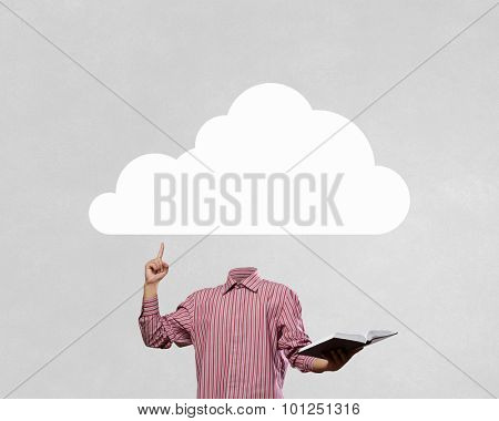 Businessman with cloud instead of head holding book in hand