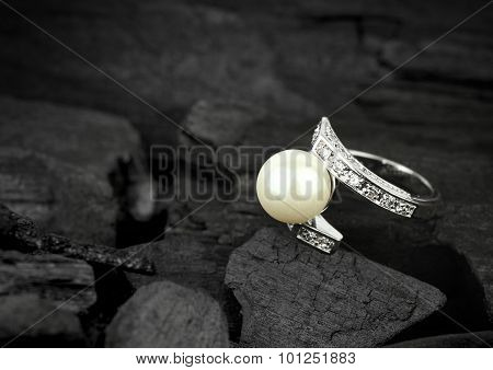 Jewelry With Brilliant And Pearl On Dark Coal Background, Soft Focus