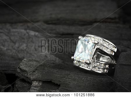 Jewelry Ring Witht Big Brilliant On Dark Coal Background