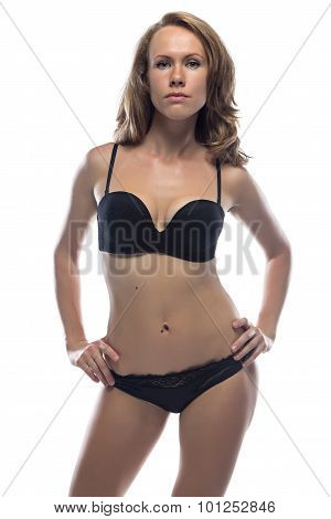 Blond woman in lingerie with hands on hips