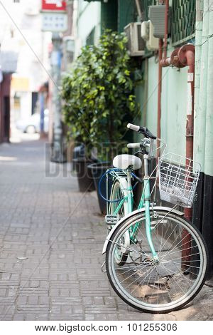 Retro Style Bicycle At Narrow Street
