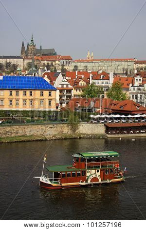 Prague, Czech Republic - April 24, 2013: Old-fashioned Boat Floating On The Vltava River Along The M