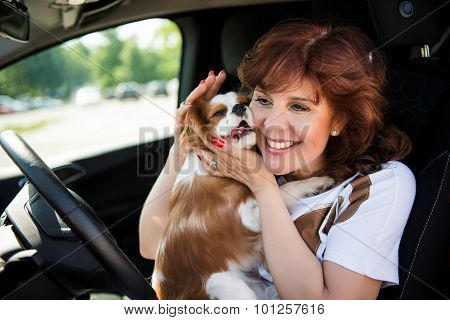 Woman with her dog in car