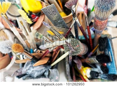 Artist brushes close up