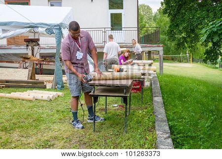 Man sanding the log