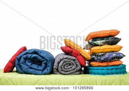 textiles, pillows, blankets on the mattress