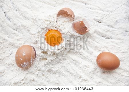 Eggs in a pile of flour