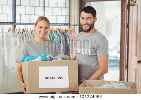 Portrait of woman holding donation box in office