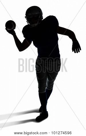 Silhouette American football player throwing ball over white background