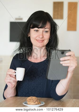 Smiling Woman At Kitchen