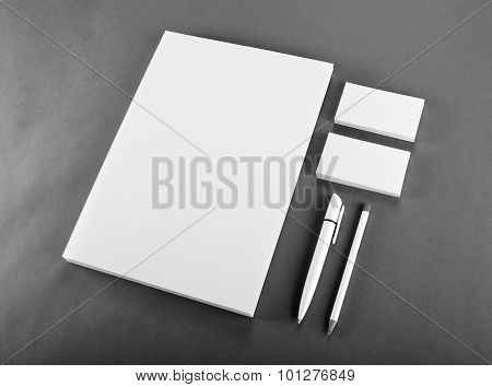 Blank Stationery On Gray Background. Consist Of Business Cards, A4 Letterheads, Pen And Pencil.