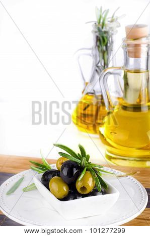Olive Oil And Olive Branch On The Table